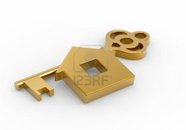 8146907-gold-key-and-little-toy-house-on-white