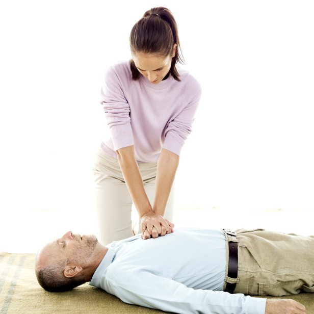 Young Woman Performing Cardiopulmonary Resuscitation