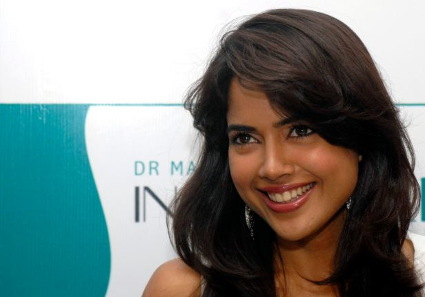 Bollywood actress Sameera Reddy smiles in Hyderabad