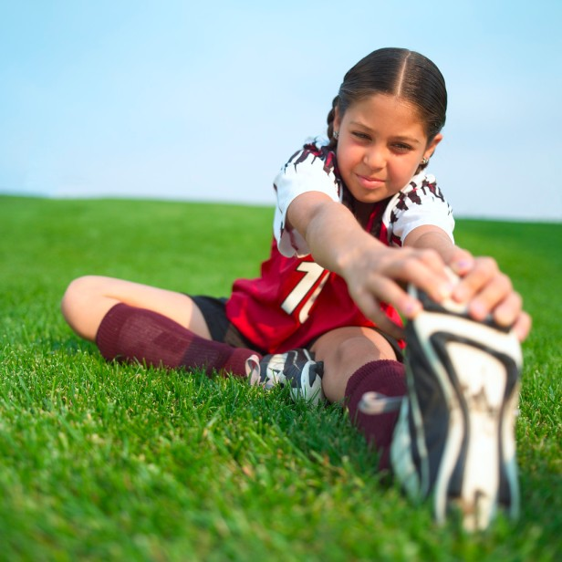 Little Soccer Player Stretching
