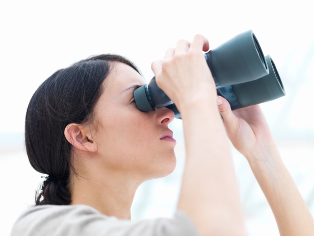 Young lady looking through binoculars